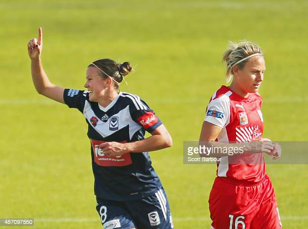 Amy Jackson of Melbourne celebrates after scoring a goal as Katie Holtham of Adelaide looks on during the round five W-League match between Melbourne...