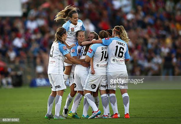 Amy Jackson of Melbourne City celebrates with team mates after scoring a goal during the round 14 W-League match between the Newcastle Jets and...