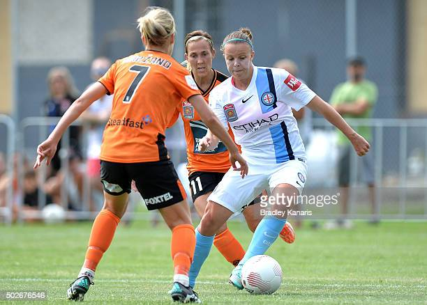 Amy Jackson of Melbourne City looks to take on the defence during the round 11 W-League match between Brisbane Roar and Melbourne City FC at Perry...