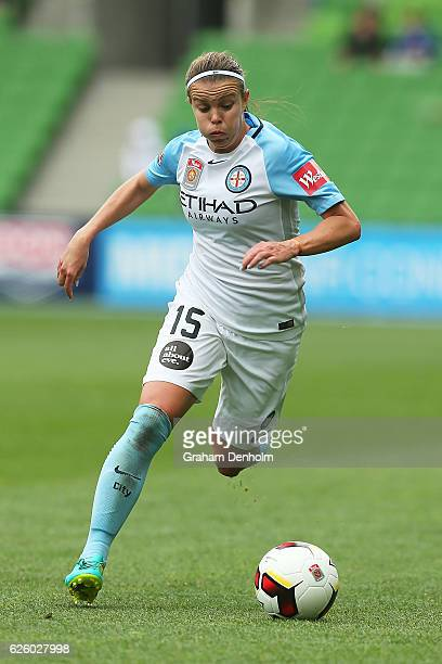 Amy Jackson of Melbourne City runs with the ball during the round four ALeague match between Melbourne City FC and Melbourne Victory at AAMI Park on...