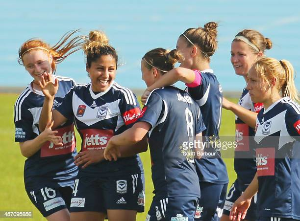 Amy Jackson of Melbourne is congratulated by her teammates after scoring her third goal during the round five W-League match between Melbourne and...