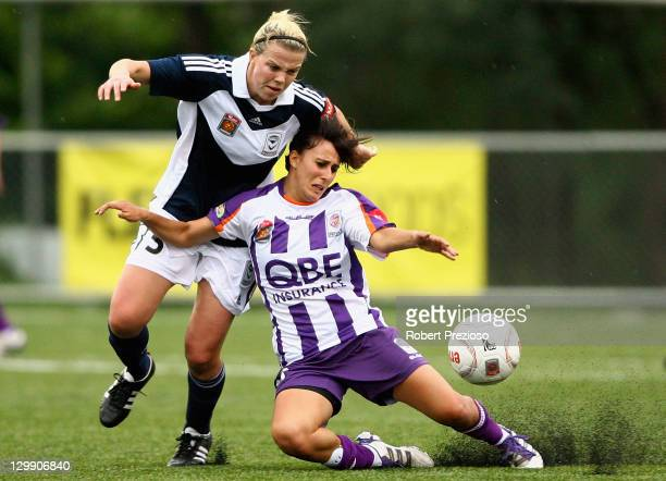 Amy Jackson of the Victory and Elisa D'Ovidio of the Glory contest the ball during the round one W-League match between the Melbourne Victory and...