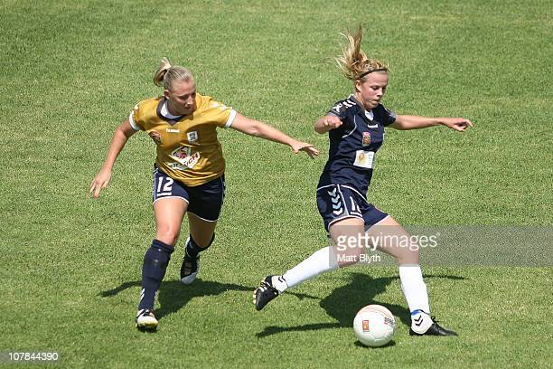 Amy Jackson of the Victory and Melissa Feuerriegel of the Jets compete for the ball during the round eight W-League match between the Newcastle Jets...