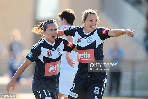 Amy Jackson of the Victory celebrates with teammate Lisa De Vanna of the Victory after scoring a goal during the round two WLeague match between the...