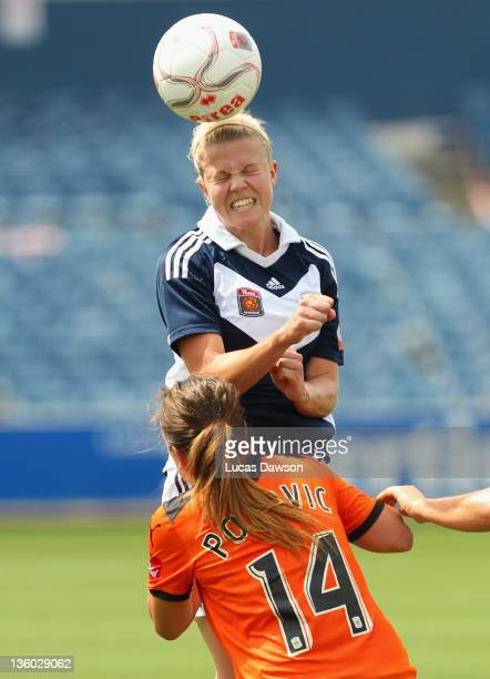 Amy Jackson of The Victory heads the ball during the round nine W-League match between the Melbourne Victory and the Brisbane Roar at Simonds Stadium...