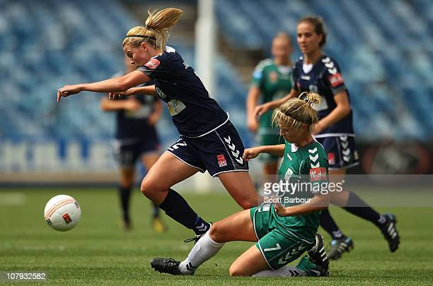 Amy Jackson of the Victory trips after being tackled by Ellie Brush of Canberra during the round nine W-League match between the Melbourne Victory...