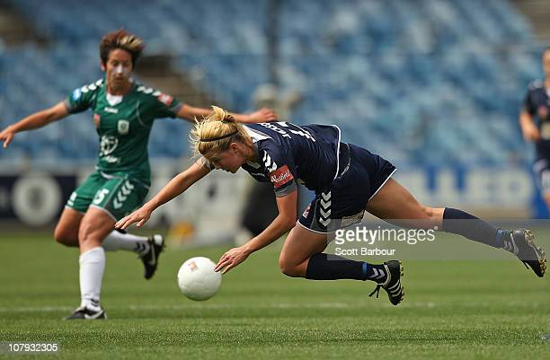 Amy Jackson of the Victory trips after being tackled during the round nine W-League match between the Melbourne Victory and Canberra United at...