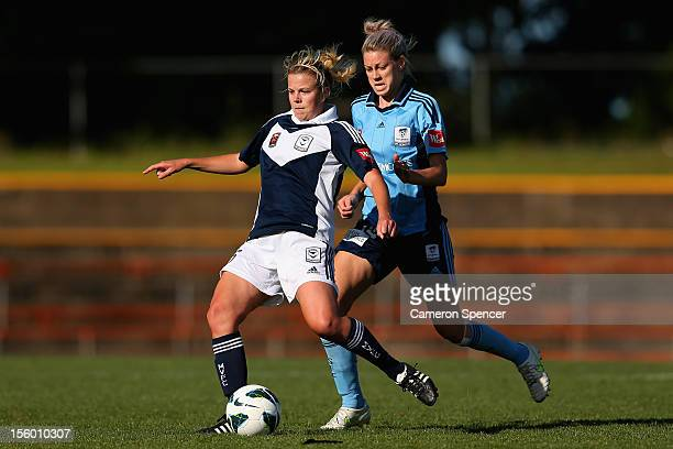 Amy Jackson of Victory kicks the ball ahead of Alanna Kennedy of Sydney FC during the round four W-League match between Sydney FC and the Melbourne...