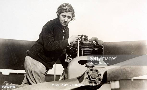 Amy Johnson CBE a pioneering English aviatrix seen here adjusting the engine of a de Havilland DH60 Moth Flying solo or with her husband Jim Mollison...