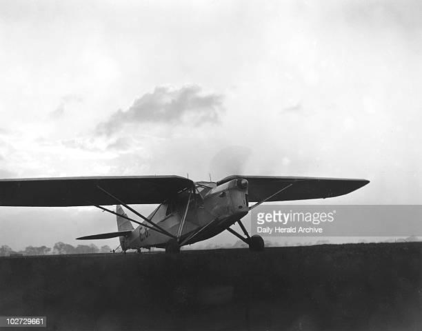Amy Johnson flying 'Desert Cloud', 8 November 1932. Photograph by James Jarche; 'Solo Flight to Australia - Amy Johnson in her new plane, Desert...