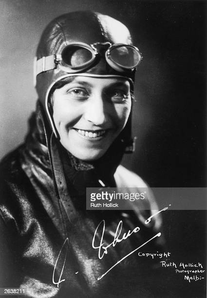 Amy Johnson the English pioneer aviator later married to Captain Jim Mollison in her aviators costume with her signature