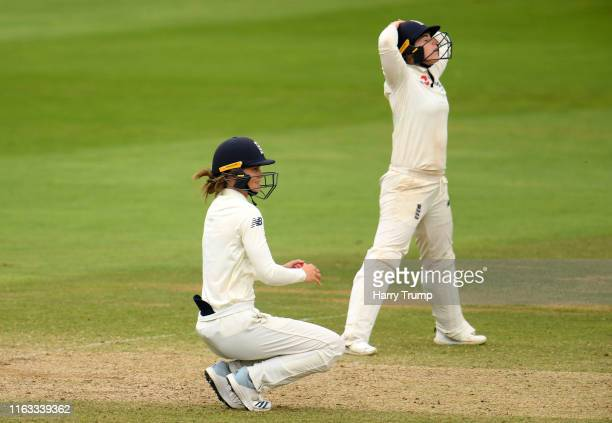 Amy Jones and Tammy Beaumont of England react during Day Four of the Kia Women's Test Match between England Women and Australia Women at The Cooper...