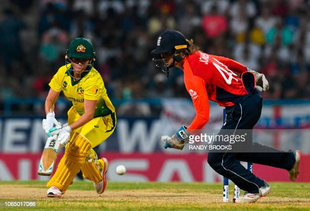 Amy Jones of England attempts to catch Beth Mooney of Australia during the ICC Women's World T20 final cricket match between Australia and England at...