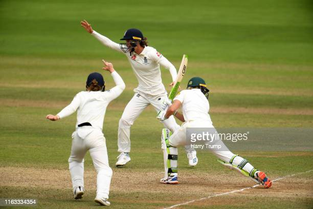 Amy Jones of England celebrates the wicket of Alyssa Healy of Australia during Day Four of the Kia Women's Test Match between England Women and...