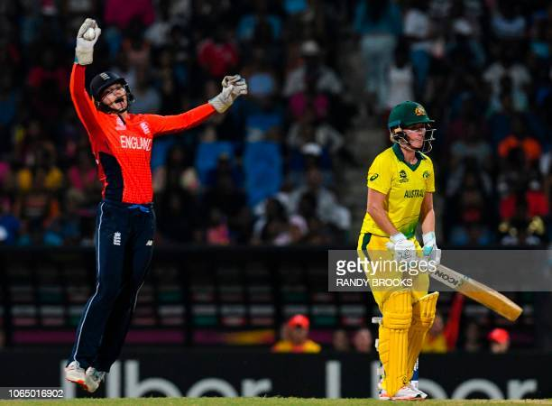 Amy Jones of England takes the catch to dismiss Beth Mooney of Australia during the ICC Women's World T20 final cricket match between Australia and...
