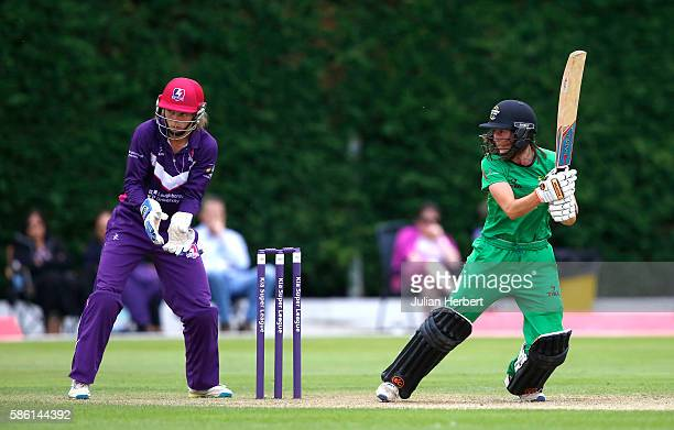 Amy Jones of Loughbrough Lightning looks on as Fran Wilson of Western Storm hits out during the Kia Super League women's cricket match between...