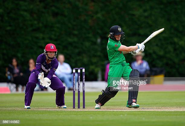 Amy Jones of Loughbrough Lightning looks on as Heather Knight of Western Storm hits out during the Kia Super League women's cricket match between...