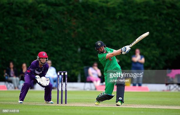 Amy Jones of Loughbrough Lightning looks on as Rachel Priest of Western Storm hits out during the Kia Super League women's cricket match between...