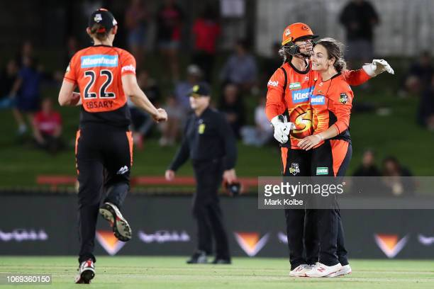 Amy Jones of the Scorchers congratulates Heather Graham of the Scorchers as she celebrates taking the wicket of Ashleigh Gardner of the Sydney Sixers...