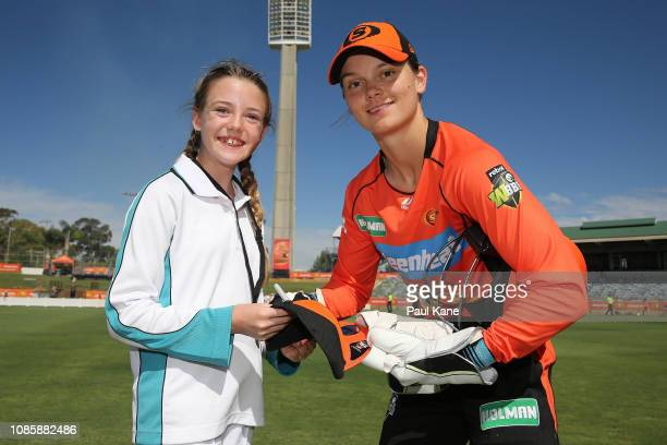 Amy Jones of the Scorchers poses with a young cricket player during the Women's Big Bash League match between the Perth Scorchers and the Melbourne...