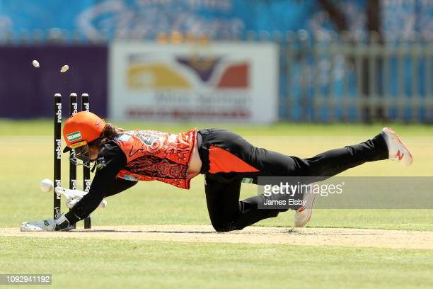 Amy Jones of the Scorchers runs out AmandaJade Wellington of the Adelaide Strikers during the Women's Big Bash League match between the Adelaide...