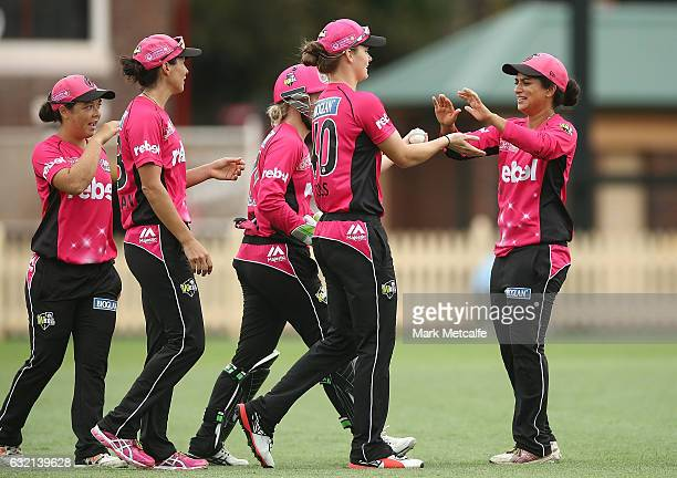 Amy Jones of the Sixers celebrates with team mates after taking a catch to dismiss Danni Wyat of the Renegades during the Women's Big Bash League...