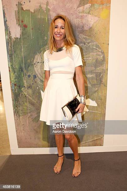 Amy Kern, wearing a dress by Elizabeth and James, shoes by Lanvin, a bag by Marni and bracelets by Elsa Peretti, attends Art Basel Miami Beach 2013...
