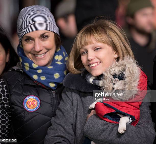 Amy Kule and singer Grace VanderWaal attend the 90th anniversary Macy's Thanksgiving day parade rehearsals at Macy's Herald Square on November 22...