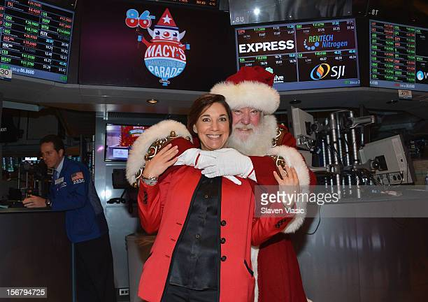 Amy Kule Executive Producer of Macy's Thanksgiving Day Parade and Santa Claus visit the New York Stock Exchange on November 21 2012 in New York City