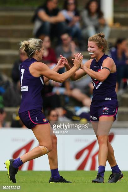 Amy Lavell and Kellie Gibson of the Dockers celebrate a goal during the round seven AFLW match between the Fremantle Dockers and the Carlton Blues at...