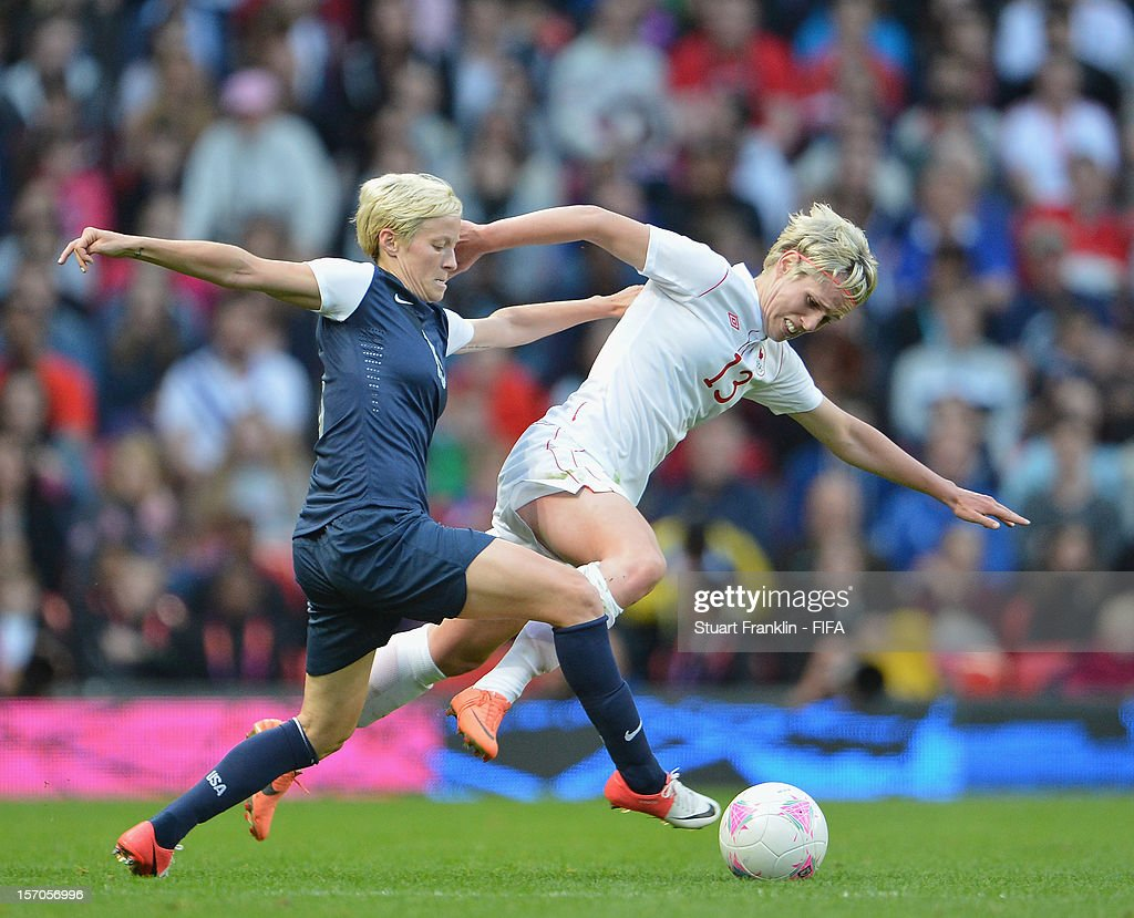 Amy Le Peilbet of USA challenges for the ball with Sophie Schmidt of Canada during the Women's Football Semi Final match between Canada and USA, on Day 10 of the London 2012 Olympic Games at Old Trafford on August 6, 2012 in Manchester, England.