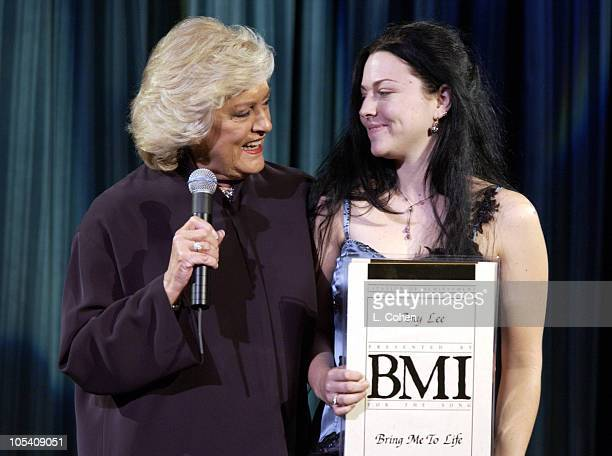 Amy Lee recieves her BMI award from Frances W Preston president/CEO of BMI