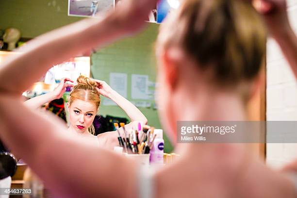 Amy Lennox playing 'Princess Pertunia' prepares in her dressing room prior to the Puss in Boots pantomime at the Hackney Empire on December 6 2013 in...