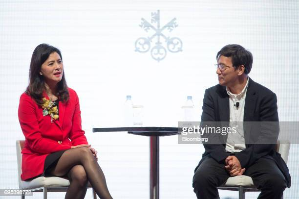 Amy Lo chief executive officer for Hong Kong at UBS Wealth Management speaks as Li Zexiang chairman of SZ DJI Technology Co looks on during the UBS...