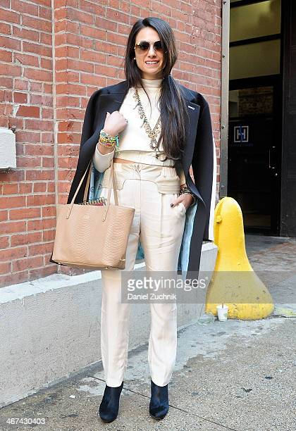 Amy Marietta is seen outside the Costello Tagliapietra show wearing Samantha Wills necklace Big Bang NY ring Kim and Zozi bracelets GiGi NY bag and...