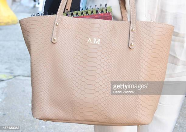 Amy Marietta is seen outside the Costello Tagliapietra show with a GiGi NY bag on February 6 2014 in New York City