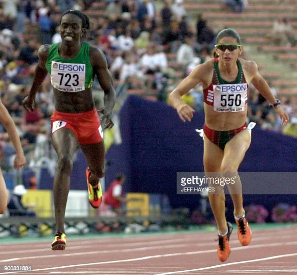 Amy Mbacke Thiam of Senegal and Ana Guevara of Mexico lunge for the finish line of the women's 400M final at the 8th World Championships in Athletics...