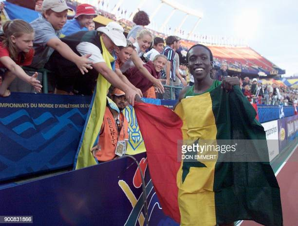 Amy Mbacke Thiam of Senegal celebrates her win of the women's 400M final at the 8th World Championships in Athletics 07 August 2001 in Commonwealth...