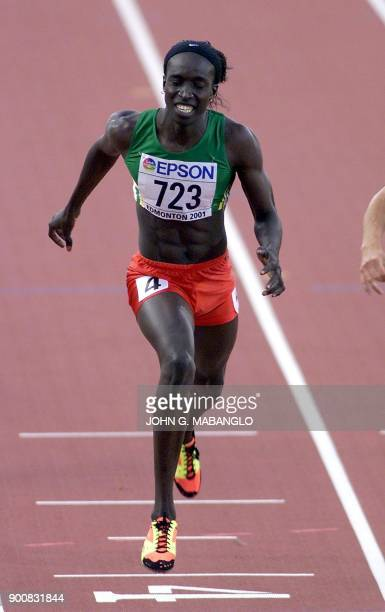 Amy Mbacke Thiam of Senegal lunges for the finish line of the women's 400M final at the 8th World Championships in Athletics 07 August 2001 in...