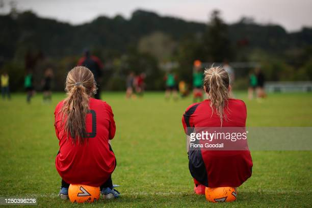 Amy McMurtrie and Anna Williams-Mart watch the match at training for the Warkworth Football Club 13th grade girls Phoenix team at Shoesmith Domain,...