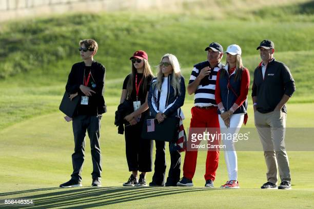 Amy Mickelson and her children watch her husband Phil during the final day singles matches matches in the 2017 Presidents Cup at the Liberty National...