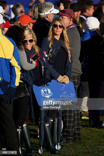 Amy Mickelson and Jillian Stacey follow Phil Mickelson and Keegan Bradley of the United States during the Morning Fourballs of the 2014 Ryder Cup on...
