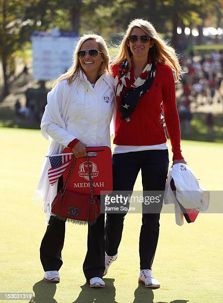 Amy Mickelson and Jillian Stacey follow the play of Phil Mickelson and Keegan Bradley during day two of the Morning Foursome Matches for The 39th...
