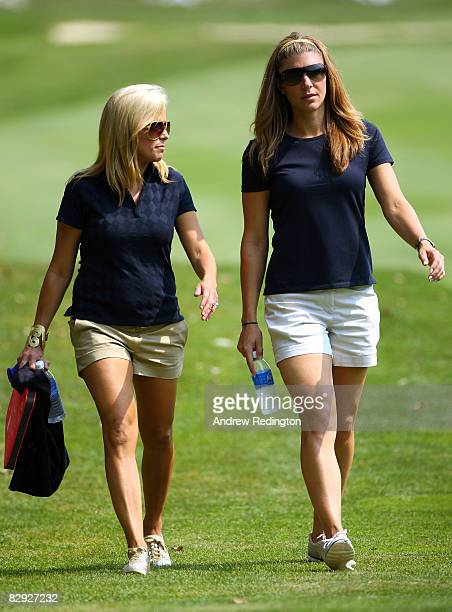 Amy Mickelson and Lisa Pruett watch the play during the afternoon fourball matches on day two of the 2008 Ryder Cup at Valhalla Golf Club on...