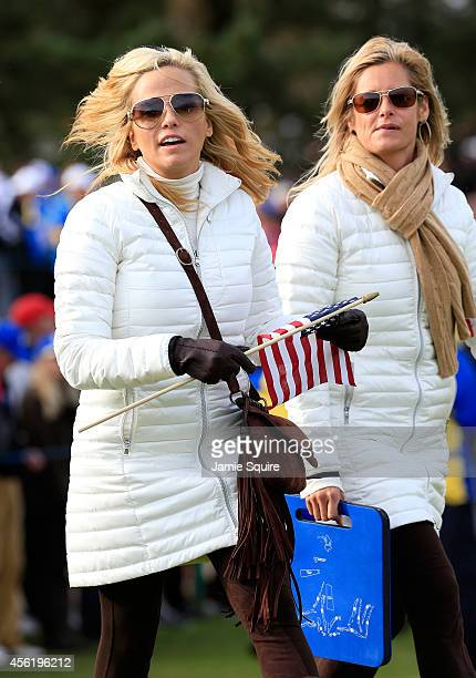 Amy Mickelson and Tabitha Furyk walk the course during the Afternoon Foursomes of the 2014 Ryder Cup on the PGA Centenary course at the Gleneagles...