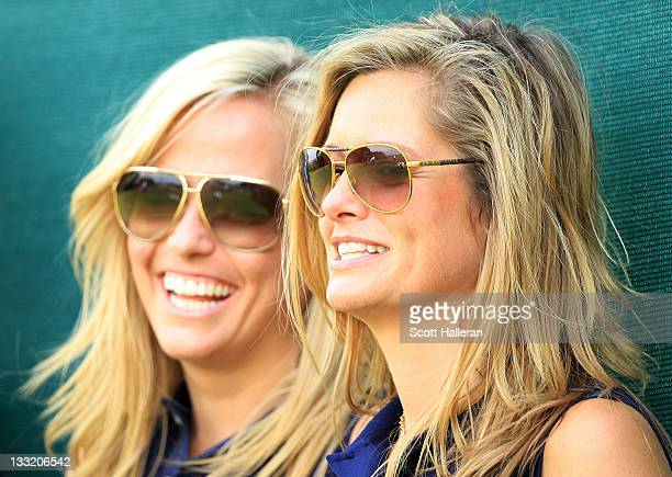 Amy Mickelson and Tabitha Furyk watch play during the Day Two FourBall Matches of the 2011 Presidents Cup at Royal Melbourne Golf Course on November...