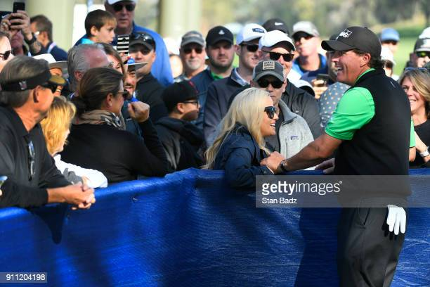 Amy Mickelson greets her husband Phil Mickelson before the third round of the Farmers Insurance Open at Torrey Pines South on January 27 2018 in San...