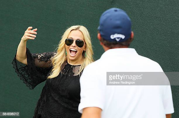 Amy Mickelson greets husband Phil Mickelson of the United States on the 18th hole after his third round of the 2016 PGA Championship at Baltusrol...