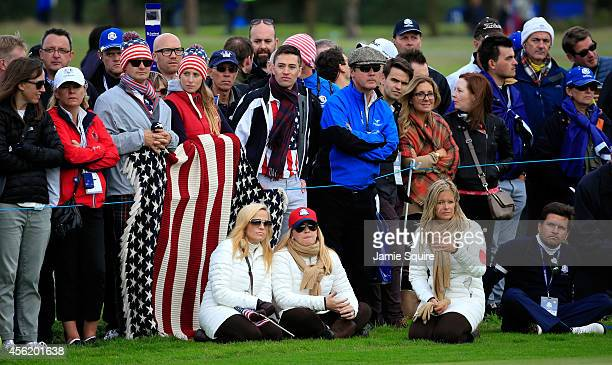Amy Mickelson Kandi Mahan and Tabitha Furyk watch during the Afternoon Foursomes of the 2014 Ryder Cup on the PGA Centenary course at the Gleneagles...
