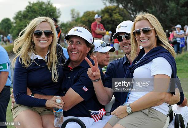 Amy Mickelson Phil Mickelson Hunter Mahan and Kandi Mahan of the US Team ride off the course during the first round of The Presidents Cup at The...